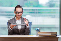 The businesswoman working with tablet computer in business concept Stock Image