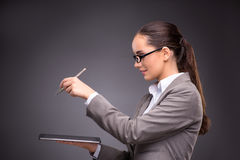 The businesswoman working on tablet computer in business concept Stock Photo