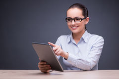 The businesswoman working with tablet computer in business concept Royalty Free Stock Images