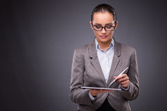 The businesswoman working on tablet computer in business concept Stock Photography