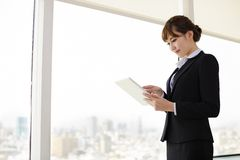 Businesswoman Working On Tablet Computer Royalty Free Stock Image