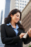 Businesswoman Working On Tablet Computer Outside Office Royalty Free Stock Photo