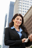 Businesswoman Working On Tablet Computer Outside Office Stock Photography