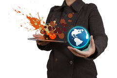 Businesswoman working with tablet computer showing the earth and Stock Image