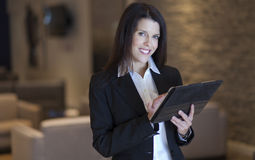 Businesswoman working on a tablet at the hotel Stock Photo