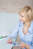 Businesswoman working on tablet-pc Stock Photos