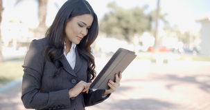 Businesswoman Working With Tablet On Street Stock Photography