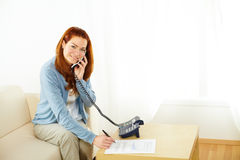 Businesswoman working and talking at phone Royalty Free Stock Images