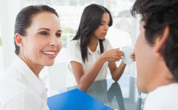 Businesswoman working with team mate Stock Image
