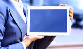 Businesswoman working with touchpad outdoor Royalty Free Stock Images