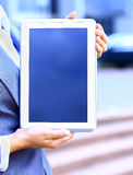 Businesswoman working with touchpad outdoor Stock Photo