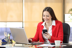 Businesswoman working using a smart phone Stock Photo