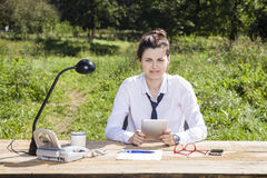 Businesswoman working on vacation Stock Image