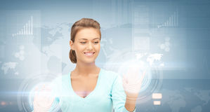 Businesswoman working with virtual screens Stock Photography