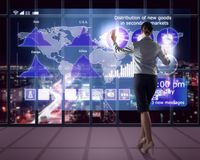 Businesswoman working with virtual technologies Stock Photos