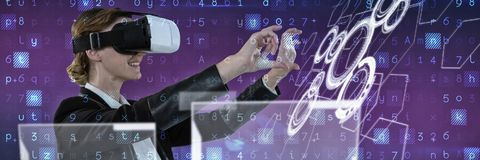 Composite image of businesswoman working with vr stock photo