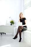 Businesswoman in the workplace Stock Images