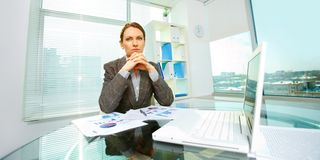 Businesswoman at workplace Stock Images
