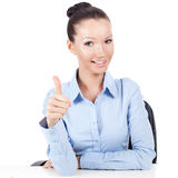 Businesswoman on workplace doing gesture thumbs up Royalty Free Stock Photo