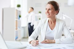 Businesswoman at workplace Royalty Free Stock Images