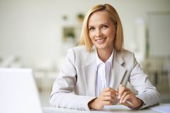 Businesswoman at workplace Stock Image
