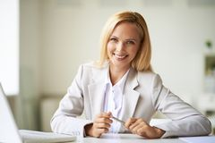 Businesswoman at workplace Stock Photo