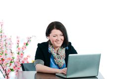 The businesswoman works at the computer Stock Images