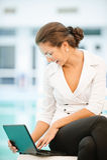 Businesswoman works on laptop Royalty Free Stock Photo