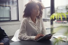 Businesswoman works in office with a tablet. Concept of internet sharing and company startup. Businesswoman works in office with a tablet during a meeting stock images