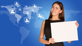 Businesswoman with world map, network and people. Businesswoman hold paper sheet. World map with network and people icons as backdrop Royalty Free Stock Image