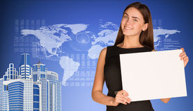 Businesswoman with world map, skyscrapers and Royalty Free Stock Image