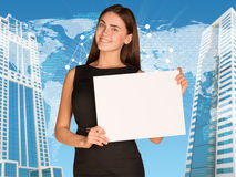 Businesswoman with world map and skyscrapers Royalty Free Stock Photos