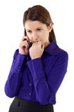 A businesswoman worries over the phone. A businesswoman worries about bad business news or crisis Stock Image
