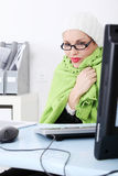 Businesswoman wrapped on blanket feeling cold. Royalty Free Stock Photos