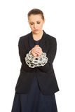 Businesswoman wrapped with metal chain. Stock Photography