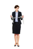 Businesswoman wrapped with metal chain. Stock Photos