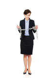 Businesswoman wrapped with metal chain. Royalty Free Stock Images