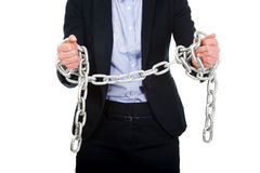 Businesswoman wrapped with metal chain. Royalty Free Stock Photos