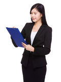 Businesswoman write on clipboard Royalty Free Stock Images