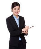 Businesswoman write on clipboard. Isolated on white background Royalty Free Stock Photography