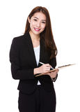 Businesswoman write on clipboard. Isolated on white background Stock Photo