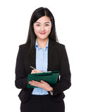 Businesswoman write on clipboard Stock Photo