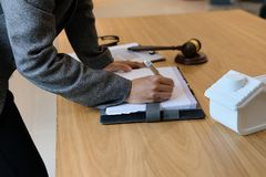 businesswoman write note with house model stock photo