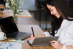Businesswoman write note on notebook at workplace. startup woman stock photos
