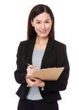 Businesswoman write on notepad Stock Photo