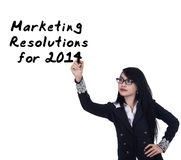 Businesswoman writes marketing resolutions Royalty Free Stock Photography