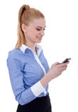 Businesswoman writes a text message Stock Photography