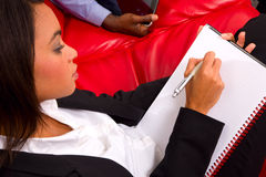 Businesswoman writing Stock Image