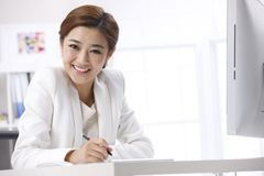 Businesswoman writing Stock Photography