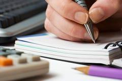 businesswoman writing Стоковая Фотография RF